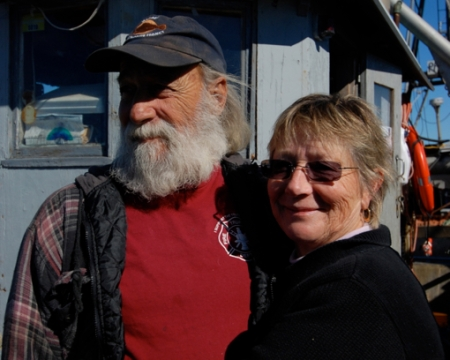 """Capt. David Dutra of the Richard & Arnold, and Judy Dutra, author of """"Nautical Twilight,"""" Provincetown (2012), by David W. Dunlap."""