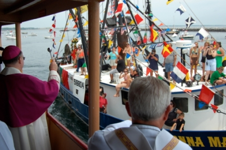 Bishop George W. Coleman and the Donna Marie, Blessing of the Fleet, Provincetown (2011), by David W. Dunlap.