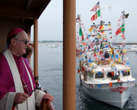 Bishop George W. Coleman and the Glutton, Blessing of the Fleet, Provincetown (2011), by David W. Dunlap.