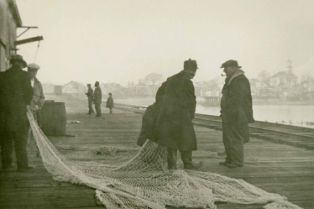 """Railroad Wharf With Fishermen,"" by Ross Moffett (ND). Courtesy of the Provincetown History Preservation Project (Moffett Collection)."