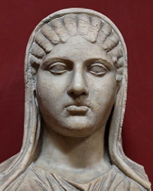 Bust of Aspasia, identified through an inscription. Marble, Roman copy after a Hellenistic original. From Torre della Chiarrucia (Castrum Novum) near Civitavecchia. Museo Pio-Clementino, Muses Hall. Wikimedia Commons.