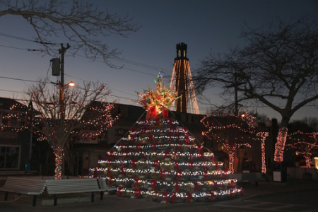 """Lobster Pot Tree and Pilgrim Monument with Lights,"" by Ewa Nogiec. From ""Beautiful Autumn,"" I Am Provincetown."