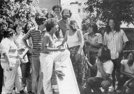 "6 Gosnold Street, Provincetown (1979). ""The Provincetown Drop-In Center, summer 1979."" Jay Critchley and Dr. Doug Kibler at top, surrounded by fellow staffers. Photograph, from the collection of Jay Critchley, published in ""Ptown: Art, Sex and Money on the Outer Cape,"" by Peter Manso (2002)."