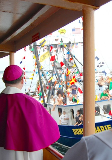 Bishop George Coleman of Fall River blessing F/V Donna Marie from the deck of Provincetown II, by David W. Dunlap (2011).