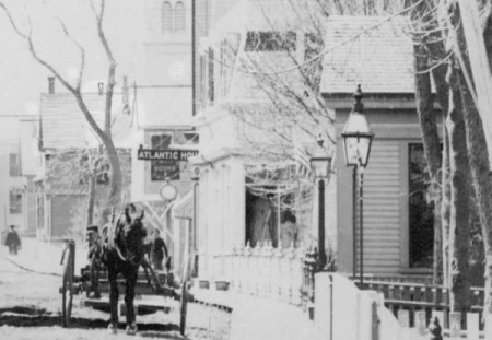 289 Bradford Street, far right, when it was at 234 Commercial Street (ca 1906), courtesy of the Provincetown History Preservation Project.